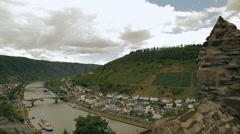 A view from the castle walls on a European town and a river Stock Footage