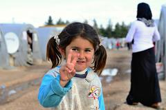 people in refugee camp - stock photo