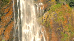 Waterfall in Europe. Water is flowing on green rocks. Stock Footage