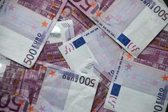 A surface with 500 euros of notes - stock photo