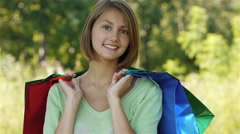 Portrait pretty young woman shopping bags Stock Footage