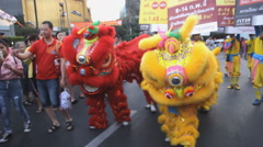 Chinese lions dancing parade to celebrate the Chinese New Year festival. Stock Footage