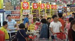 People do groceries in a busy Western style supermarket in South Korea Stock Footage