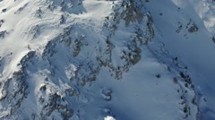 Aerial footage of a snowy moutain peak in the French Alps Stock Footage