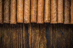 Hand rolled cigars on wooden table Kuvituskuvat