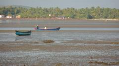 Fisherman boat by river sandbank Stock Footage