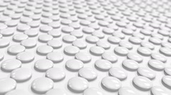 A looped a motion tween white round tablets Stock Footage