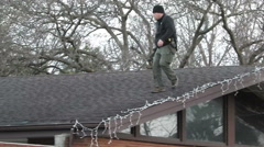 S.w.a.t. snitper setting up on a roof Stock Footage