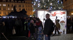 Children and adults around the Christmas tree at the Christmas Market in Prague Stock Footage