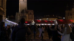 Night view of the Christmas Market organized around the Old Town Hall in Prague - stock footage