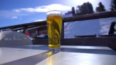 Glass of tasty beer at skiing resort Alps Stock Footage