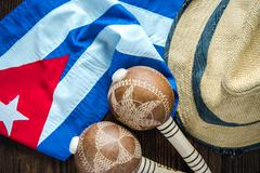 Cuban flag, panama hat and musical instrumet. - stock photo