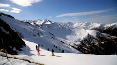 Alps mountains view with skiers - stock footage