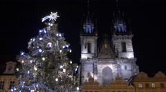Night view of the Christmas tree and the Church of our Lady in Prague - stock footage
