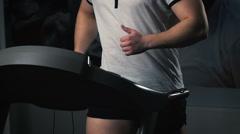 Man On Running Machine In Gym Stock Footage