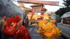 Chinese lions dancing parade to celebrate the Chinese New Year festival Stock Footage