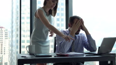 Young businessman getting rebuke from his female boss in the office, 4K - stock footage