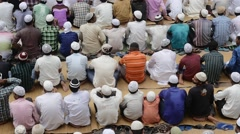 Indian muslims praying to Allah Stock Footage