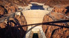 Aerial View of Hoover Dam and Shadow of Pat Tillman Bridge Stock Photos
