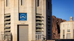 Clock Showing Nevada Time at The Hoover Dam - stock photo