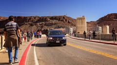 Traffic and Tourists Cross Hoover Dam - stock photo