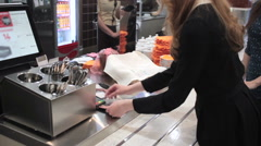 Young girl pays card in the cafe Stock Footage