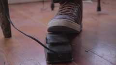 Close up of leather laced shoe depressing electric foot pedal from front Stock Footage