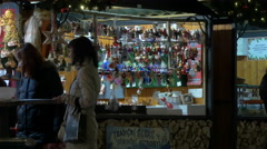 Stock Video Footage of Women standing near souvenir stalls at the Christmas Market in Prague