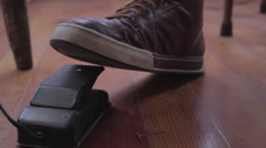 Close up of leather laced shoe depressing electric foot pedal from side Stock Footage