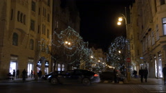 Pařížská street with cars and decorated trees seen at night in Prague Stock Footage
