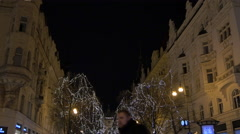 Pařížská street with decorated trees seen on a Christmas night in Prague Stock Footage