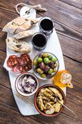 Authentic tapas served on marble board - stock photo