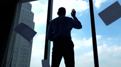 Happy businessman throwing document while standing by the window, super slow mot Stock Footage