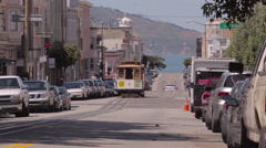 San Francisco Cable Car riding uphill bay harbor in background Jackson street Stock Footage