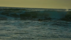 Surfer goes under a wave - stock footage