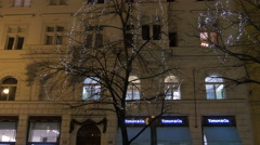 Decorated tree seen at Christmas in front of the Tiffany & Co. shop in Prague Stock Footage