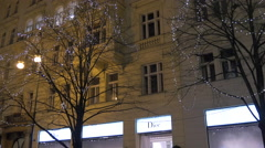 Decorated tree seen at Christmas in front of Dior shop in Prague - stock footage