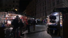 Souvenir stalls seen at night in the Wenceslas Square Christmas Market, Prague - stock footage