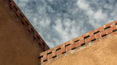 Detail of an adobe roofline with brick Stock Footage