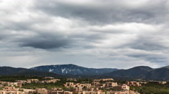 Clouds roll past a Santa Fe suburb Stock Footage