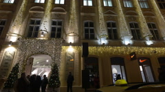 Hypnose store with decorations seen on a Christmas night in Prague Stock Footage