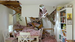 Tornado winds sends huge tree into a playroom Stock Footage