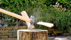 Lumberjack chopping wood slow motion Stock Footage