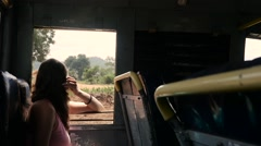 Beautiful caucasian girl looking out of indian bus window Stock Footage