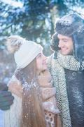 Portrait of couple in winter clothes on a beautiful snowy day Stock Photos