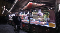 Boutiques with sweets at the Christmas Market in Prague - stock footage