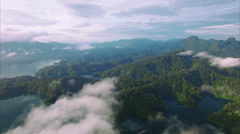 Ban Wang Khon, Surat Thani, Through Clouds, Island, Panning Right, Sun on Hills Stock Footage