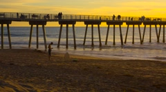 Young man drying off at beach during sunset 2 Stock Footage