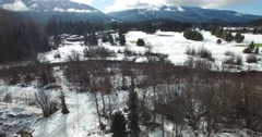 Beautiful aerial flight over whistler golf course covered in snow Stock Footage