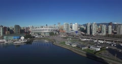 Aerial flight towards bc place on sunny day Stock Footage